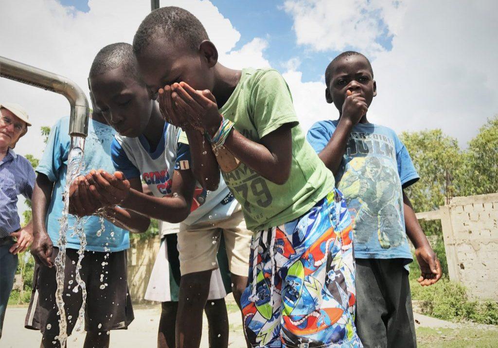 Children with water pump
